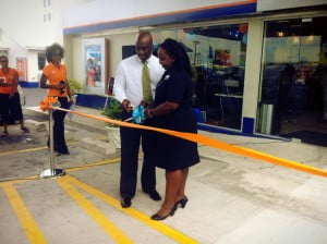 {IMAGE VIA - facebook.com/solbarbados} Kaiya Investments' Tonya Trotman with Country Manager for SOL Barbados, Ezra Prescod officially sever the ribbon to allow even more patrons to enjoy the bounty found at Warrens! (CLICK FOR BIGGER)