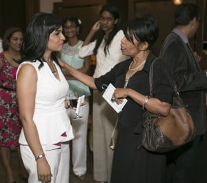 (L-R) TW Wed-Zine Founder and Editor Simone Sant-Ghuran receives compliments from Fashion designer Claudia Pegus at the 2013 magazine's launch at Jaffa