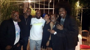 The band and Wyclef Jean pause for a photo opportunity while out at dinner