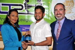 Sharda Veeren-Chand of Demerara Distillers Limited, Guyana Amazon Warriors Captain Ramnaresh Sarwan and Commercial Director of Limacol CPL Jamie Stewart