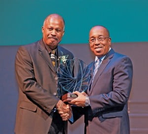 Andrew Rollins, CFO of Sol, receiving The Benefactors Award from Professor Sir Hilary Beckles, Pro-Vice Chancellor and Principal of the UWI Cave Hill Campus for Sol's major contribution to the institution over the last year.
