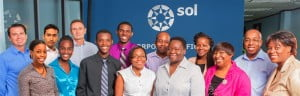 L-R (back row): David Simpson, COO; Timothy Adams, Intern; Gerard Cox, CEO; Steffan Warner, Intern; Steven Bayne, Intern; Khadija Marshall, Intern; Andrew Rollins, CFO. L-R (front row): Jehlesal Brathwaite,Intern; Chantal Griffith, Intern; Jabarrie Hurdle, Intern; Natalya Nurse, Intern; Katrina Alleyne, Intern; Pam Warner, Group HR Manager; Dianne Johnson, HR Officer.