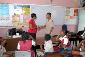 Suzette Husbands, Human Resources Manager at HIPAC is thanked for her presentation on life skills by one of the St. Mary's Primary School Class 4 students.