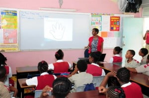 St. Mary's Primary School Class 4 students gave rapt attention to Suzette Husbands, Human Resources Manager at HIPAC as she discussed life skills which would help them as they move through secondary school.