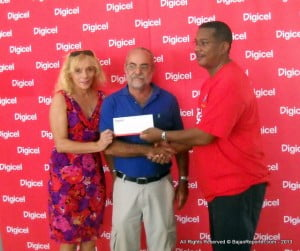 Rodney Roach (centre, blue polo) with pal Angelika Marshall (extreme left) are UK-bound thanks to Virgin Atlantic as presented by Digicel Barbados' Commercial Director, Alex Tasker
