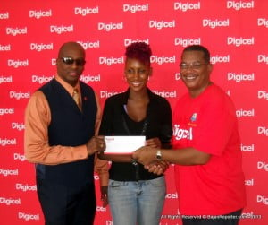 Popular Game Show presenter Mark Anthny in his true role of HR at Cave Shepherd presents C.S. ca$h to UWI student, Melodie Johnson. Reuben James also got ca$h from Courts (off-cam).