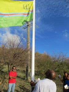 St. Martin's Unity Flag hoisted by activist Shujah Reiph in tribute to the Diamond Estate 26 and St. Martin's 165th Anniversary of Emancipation (1848-2013).