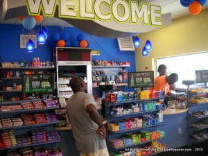 SOL understands people's needs - when Tropical Storm Chantal was brushing past Barbados, they made sure motorists were able to top up... In this candid moment the polite staff went to research a matter before answering the customer who patiently waited... (CLICK FOR BIGGER)