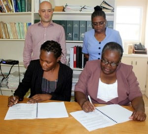 Chief Internal Auditor Romilly Murrain and Auditor General Florence Lee sign the Memorandum of Understanding as Internal Audit Advisor Mathew Byrne and Audit Manager Vernitha Weekes witness. The MOU which establishes a working mandate for the new Internal Audit Unit and the Office of the Auditor General for the Government of Montserrat.