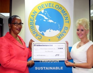 Ms. Gail Royer, Legal Counsel and Member of the Sponsorship Committee, CDB (left) presents the sponsorship cheque for the 34th Annual Crime Stoppers International Conference to Ms. Julie Dash, Chairperson of Crime Stoppers Barbados.