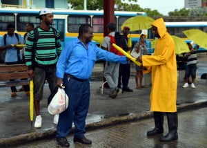 """Teams donned yellow rain coats and boats to spread the cheer in several areas. Ms. Pam Roach, Marketing Manager of the Barbados Yellow Pages noted, """"We are delighted to have contributed to the many persons who were on the roads trying to get to work... We hope that our large bright yellow umbrellas would have provided some 'sunshine' to their commute and when they use the umbrellas again it will serve to remind them that Corporate Barbados does care."""""""