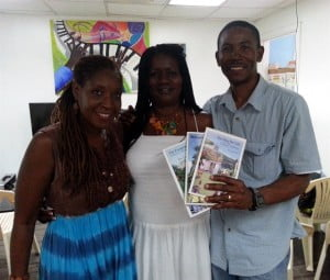 Joy Lawrence (centre) poses with host of Beyond the Screen Mitzi Allen (left) and her husband filmmaker Howard Allen on Saturday, August 17, 2013 at The Best of Books in St. John's Antigua.