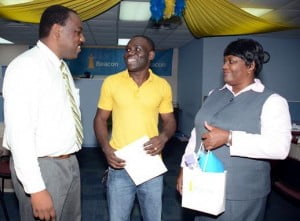 L-R: Brian Hennis, Vice President, Overseas Operations Beacon Insurance,  Henderson Barker and Odetta Odle, Branch Supervisor, Beacon Insurance