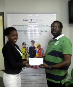 Royal Fidelity's Marketing & PR Coordinator, Tenisha Holder, presents Mr. Grazette with a donation of $1,000.00