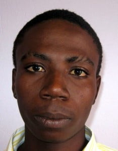 """Troyton Orwin Thegg, 21 years, alias """"Smiley"""" last known address, Kingsland Terrace, Christ Church.  He is about 5 9"""" in height, slim build, of black complexion and has brown eyes. He is wanted for questioning in connection with a serious criminal matter."""