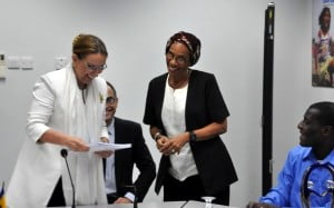 Here, Ms. Grysnpan (left) receives a document from Sandra Ferguson chair-person of the Inter-agency Group of Development Organisations (IAGDO) from Grenada
