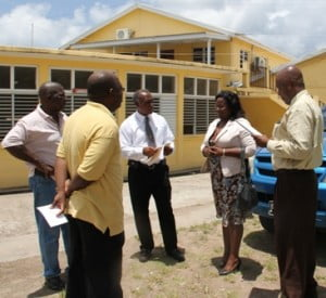Premier and Minister of Education Hon. Vance Amory (middle) with (l-r) Deputy Principal of the Charlestown Secondary School Juan Williams and Principal Edson Elliott, Permanent Secretary in the Ministry of Education and Library Services Lornette Queeley-Connor and NIA Cabinet Secretary Stedmond Tross after a tour of the school.