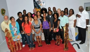 Group photo of the writers anthologized in Where I See The Sun – Contemporary Poetry in St. Martin, at the introduction of the new book during the opening of the St. Martin Book Fair 2013. (Saltwater Collection)
