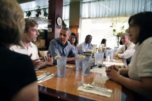 President Barack Obama, with Education Secretary Arne Duncan, meets with college students, recent graduates and educators at Magnolia's Deli & Café, during the college affordability bus tour in Rochester, N.Y., Aug. 22, 2013. (Official White House Photo by Chuck Kennedy)