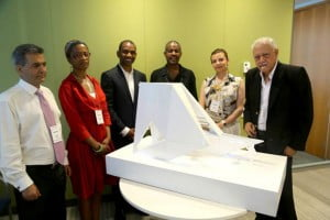 "Memorial designer Rodney Leon (standing, third from left) along side judges next to model of the ""Ark of Return,"" the winning design for the United Nations Permanent Memorial in Honor of the Victims of Slavery and the Transatlantic Slave Trade. Photo: DPI / the U.N. For more information regarding the Permanent Memorial at the United Nations to honor victims of slavery and the Transatlantic Slave Trade, please visit www.unslaverymemorial.org.  For more information regarding the award-winning work of Rodney Leon Architects, pleases visit www.rodneyleon.com"