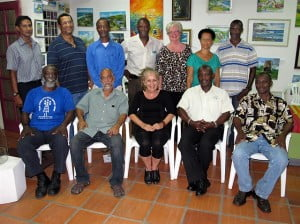 Standing (from left to right) Gordon Oliver Ashby, Raymond Patrick Maughan, Allan Ashby, Wayne Collymore-Taylor, Corrie Scott, Patricia Browne, Glenroy Jordan.   Seated (left to right)  Sylvester Adelabu Clarke, Rasheed Boodhoo, Martina Pile, Denzil Mann and Neville Legall.