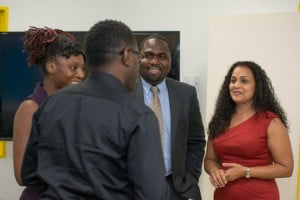 Corporate Vice President Sales and Marketing for Columbus Communications Rhea Yaw Ching (right) and General Manager of Columbus Antigua Jamal James (2nd from right) speaks with Visual Art teachers Emile Hill of Pares Secondary School and Nadia Phillips of Ottos Comprehensive School following the launch of CXC's new CAPE Digital Media Syllabus in Antigua.