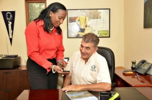 Digicel Jamaica's Head of Sales for the Western Region, Joy Clark, takes a moment to demonstrate how the Closed User Group (CUG) system works to Mystic Mountain Director, Mike Drakulich.