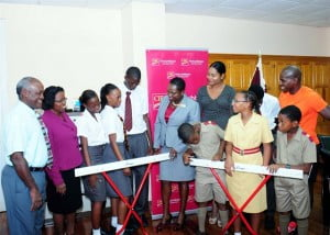 Students at Harrison College received a sporting boost recently with a donation of hurdles from CIBC FirstCaribbean Bank. Joining the students were (from left) Joseph Maynard, Principal (Acting); Sonia Nelson, Deputy Principal (Acting); Michelle Whitelaw, Director, Retail Banking Channels at CIBC FirstCaribbean; Tammi Pilgrim, President, Old Harrisonian Society; and Ryan Leacock of the P.E. Department.
