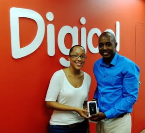 Krystal Boyea (left), Youth Ambassador for Diabetes in Barbados, accepting her new Samsung Galaxy phone, which she will be using on her journey to the summit of Mount Kilimanjaro, from Digicel Marketing Executive, Randy Howard.