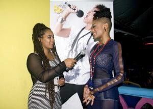 Producer of the Honey Jam Barbados TV Show, Shamkoe Pilé, interviewing artiste GiGi Ma'at.