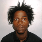 """2.Carlo Devere Hinkson alias """"Birdman"""", """"Shortman"""", or """"Blackman"""" last known address, Bridge Cot, St. George. He is about 5' 6"""" in height, slim build, of black complexion, has black eyes and a wide nose."""