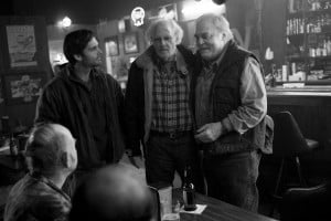 """{IMAGE VIA - collider.com} """"NEBRASKA"""" is a father and son road trip, from Billings, Montana to Lincoln, Nebraska that gets waylaid at a small town in central Nebraska, where the father grew up and has scores to settle. Told with deadpan humor and a unique visual style, it's ultimately the story of a son trying to penetrate his impenetrable father."""