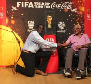 Claude Hogan (left) shakes the hand of Lionel Nanton MBE a former member of the Montserrat Football Association.