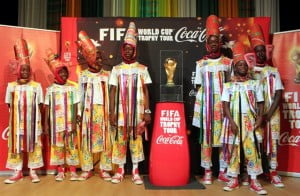 The Emerald Shamiole Masqueraders get their chance to pose next to the FIFA World Cup trophy which is on a 89-country tour ahead of the 2014 World Cup in Brazil.