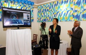 Gail Purcell, Country Manager of Flow Grenada and the Honourable Minister of Communications, Works, Physical Development, Public Utilities and ICT, Gregory Bowen applaud after the broadband speed test hits 100Mbps on Tuesday, October 1, 2013 at the Flamboyant Hotel.