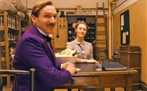 {IMAGE VIA - insidemovies.ew.com} THE GRAND BUDAPEST HOTEL recounts the adventures of Gustave H, a legendary concierge at a famous European hotel between the wars, and Zero Moustafa, the lobby boy who becomes his most trusted friend.