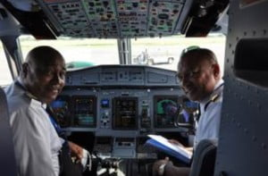 Captain Chris Cameron (left) and Captain Phil Gunsam in the flight deck of LIAT's fifth ATR aircraft