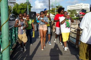 NexCyx takes to the Chamberlain Bridge in Bridgetown for a round of sno-cones during their first day of filming.