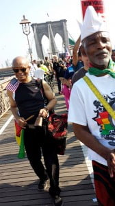 Valence Williams, l., and Menes De Griot marching over the Brooklyn bridge.  (NAN Image)