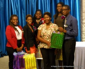 The Most Innovative Group receives their accolades from a representative of the Barbados Youth Business Trust