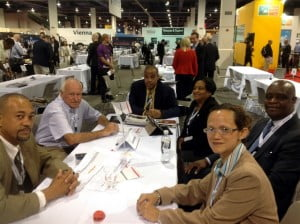 The St. Maarten delegation at the World Routes event in Las Vegas, USA. Minister Ted Richardson (2nd from right) is flanked to his right by Regina LaBega, SXM Managing Director and to his left by Suzy Kartokromo, Acting Manager, Marketing and Customer Service Dept. at SXM. Others in the photo are Edward Dest (at head of table), Interim Director of STB; Louis Halley, Head of Maritime and Civil Aviation Dept. (far left); and Nigel Harris, Managing Director, Fly Montserrat. (SXM photo)