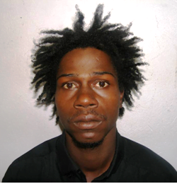 "Carlo Devere Hinkson alias ""Birdman"", ""Shortman"", or ""Blackman"" last known address, Bridge Cot, St. George.  He is about 5' 6"" in height, slim build, of black complexion, has black eyes and a wide nose."