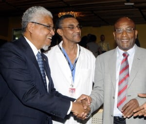 Prof. E. Nigel Harris (left), Vice Chancellor of the University of the West Indies (UWI), congratulates Prof. Joseph Frederick (right), Director, Hugh Wynter Fertility Management Unit (HWFMU) at the launch of the UWI's Single Virtual University Space (SVUS) and Telemedicine Pilot at the HWFMU, Mona, (Nov. 6, 2013).  At centre is Dr. Shaun Wynter, Consultant, HWFMU.