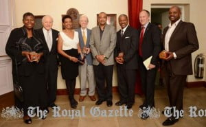 The Bermuda Arts Council held its 2013 Patron, Lifetime Achievement and Founder Awards Ceremony at the Earl Cameron Theatre at City Hall with Culture Minister Wayne Scott (centre) and Hamilton Mayor Greame Outerbridge (second from right) handing out the awards. Shown from left to right are music educator and author Persis Butler; Arts Council Patron awardee Richard Butterfield; dancer, educator and coordinator for the 2009 settlement celebrations and Founders Award winner Conchita Ming, Royal Gazette cartoonist Peter Woolcock, Mr Scott, musician Max Maybury, Mr Outerbridge and Winston DeGraff the brother of the late Winston DeGraff. Not shown is Robert Patton, nephew of author Willoughby Patton. (Photo by Akil Simmons)