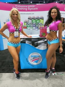 Apart from a vast array of fast cars and girls, the SEMA show displays a wide range of automobile aftermarket products, from performance and racing components to paint refinishing systems like that of Automotive Art.