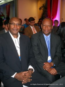 "{PERSONAL FILE IMAGE} ACM President Clive Bacchus (at left here, with Enricco Woolford) noted: ""This move by the government of Jamaica comes after many years of work by media organisations such as the PAJ and MAJ. Special mention, however, must be made of the work of the Justice Hugh Small Commission which drew its conclusions from civil society and whose report, thankfully, was not allowed to gather dust on a shelf somewhere. The ACM is also proud to have been a part of the effort to remove criminal defamation from the island's statute books."""