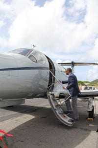Deputy Premier and Minister of Tourism Mark Brantley taking a look at an aircraft from Tradewind Aviation's fleet on the tarmac of the Vance W. Amory International Airport