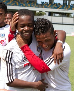 A Player from Panama congratulates one of the players from the winning Haitian team.