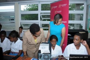 Principal of the Deighton Griffith School, Cheryll Moseley (left) and Managing Director, Barbados, CIBC FirstCaribbean, Donna Wellington chat with students Nailah Alleyne, 15, and Jair Mayers, 15 about the floor plans they're working on with the aid of computer technology.