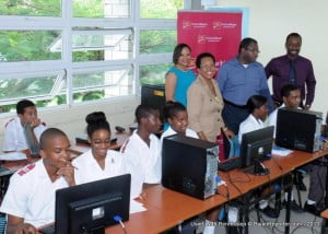 IT Coordinator at Deighton Griffith School, Andrew Edey (second from right) updates (from left) Managing Director, Barbados, CIBC FirstCaribbean, Donna Wellington; Principal, Cheryll Moseley; and Deputy Principal, Anthony Alleyne on students' progress including (from left) Franconando Carter, Danielle Currency, Tyler Marks-Bridgeman, Samantha Cadogan, Nailah Alleyne, and Jair Mayers.